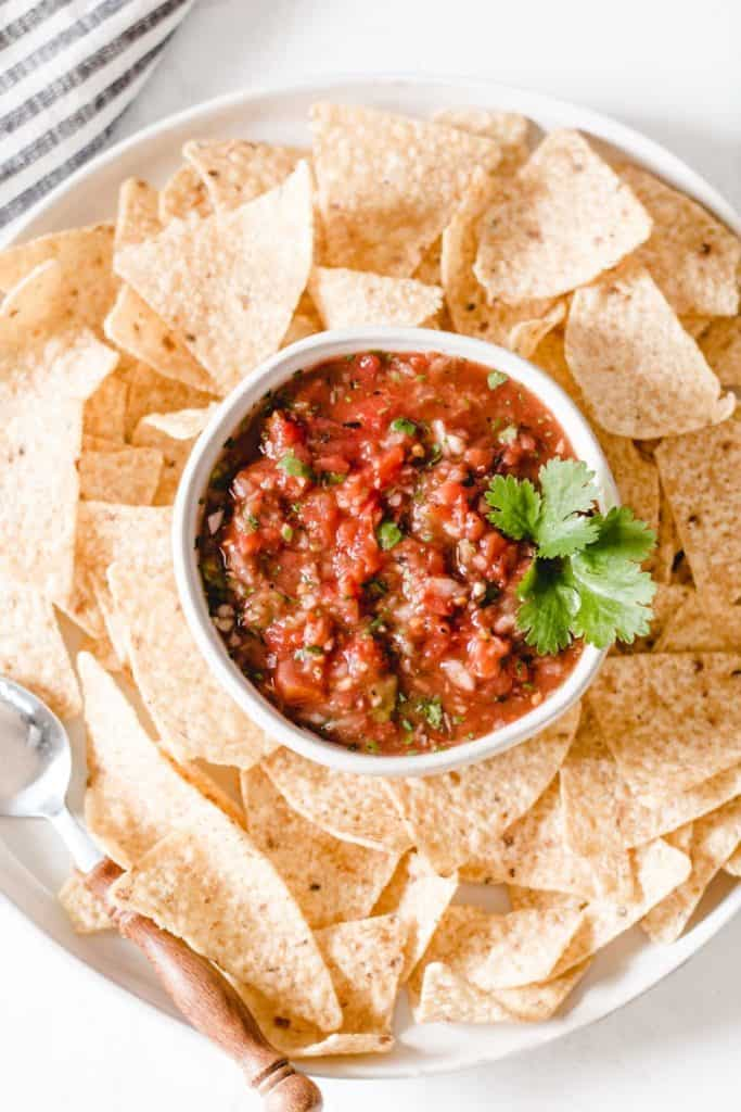 Chipotle salsa in a bowl surrounded by chips.