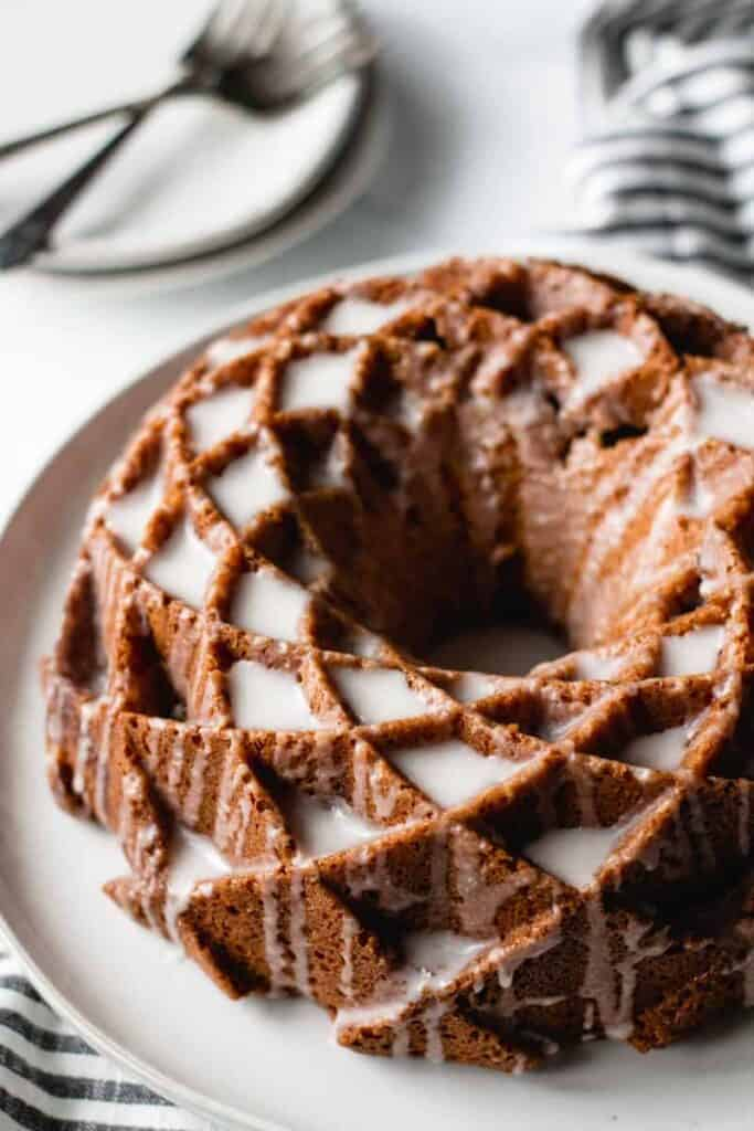 sour cream coffee cake, bundt cake on a plate, icing dripping down sides