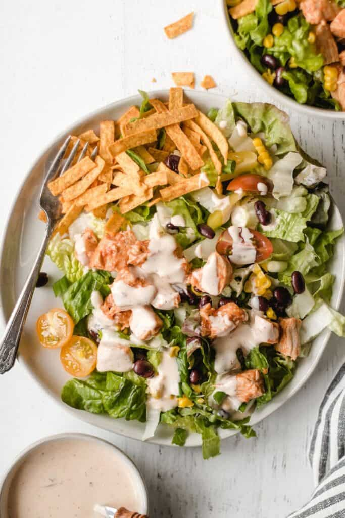 southwest bbq chicken salad with chipotle ranch dressing on top.