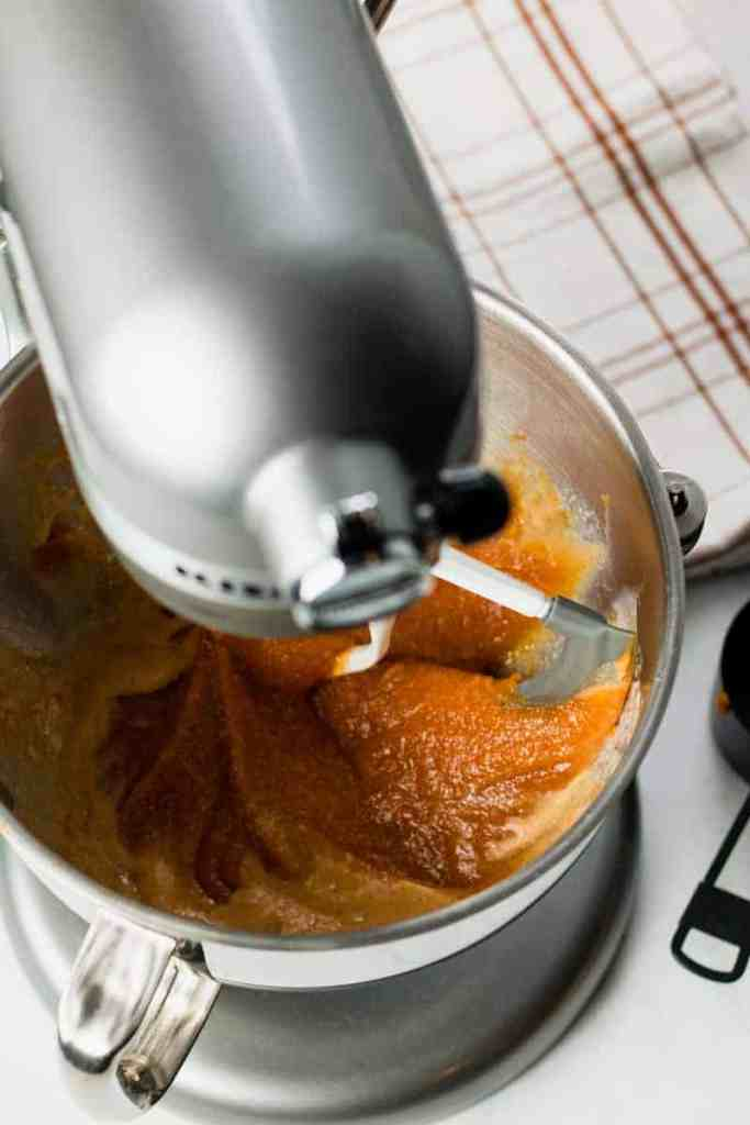 A silver kitchenmaid stand mixer mixing the wet ingredients.