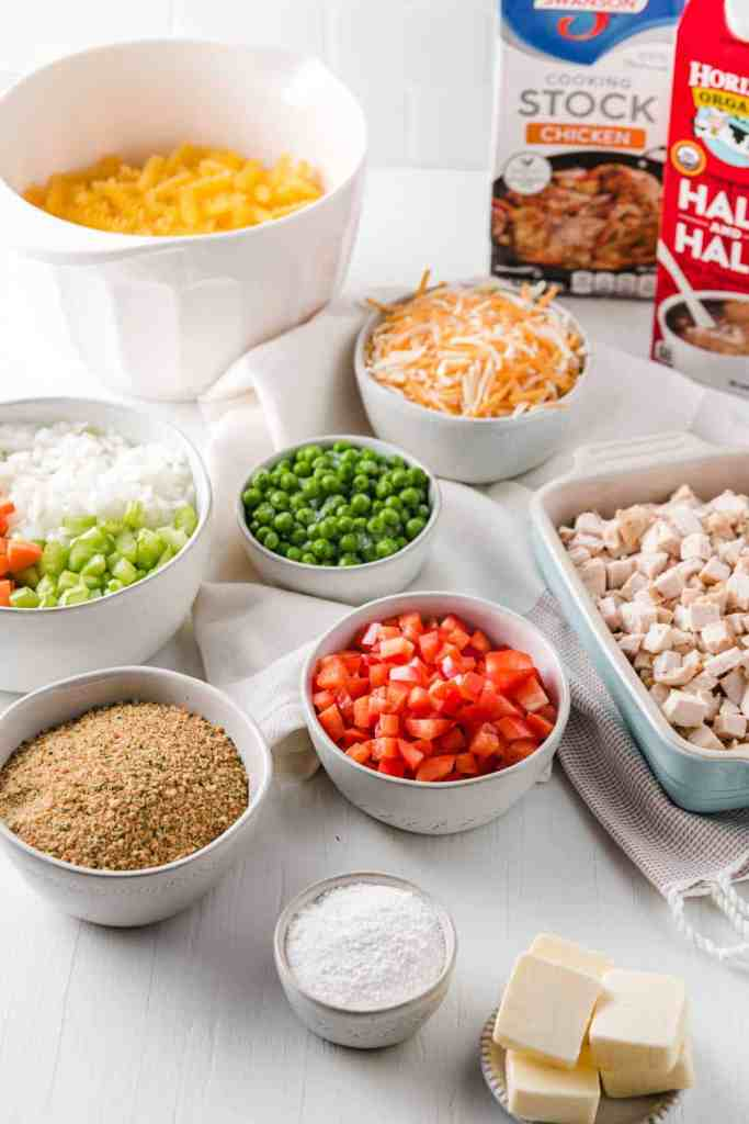 Ingredients for casserole, measured, diced and in laid out in bowls.