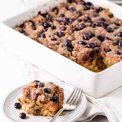 A slice of Gluten-free French Toast Casserole on a plate.