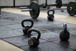 Photo: kettleballs and weights in a gym