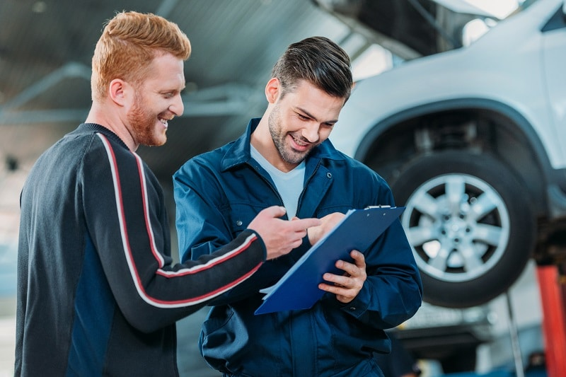 Person Signing Tire Warranty Papers