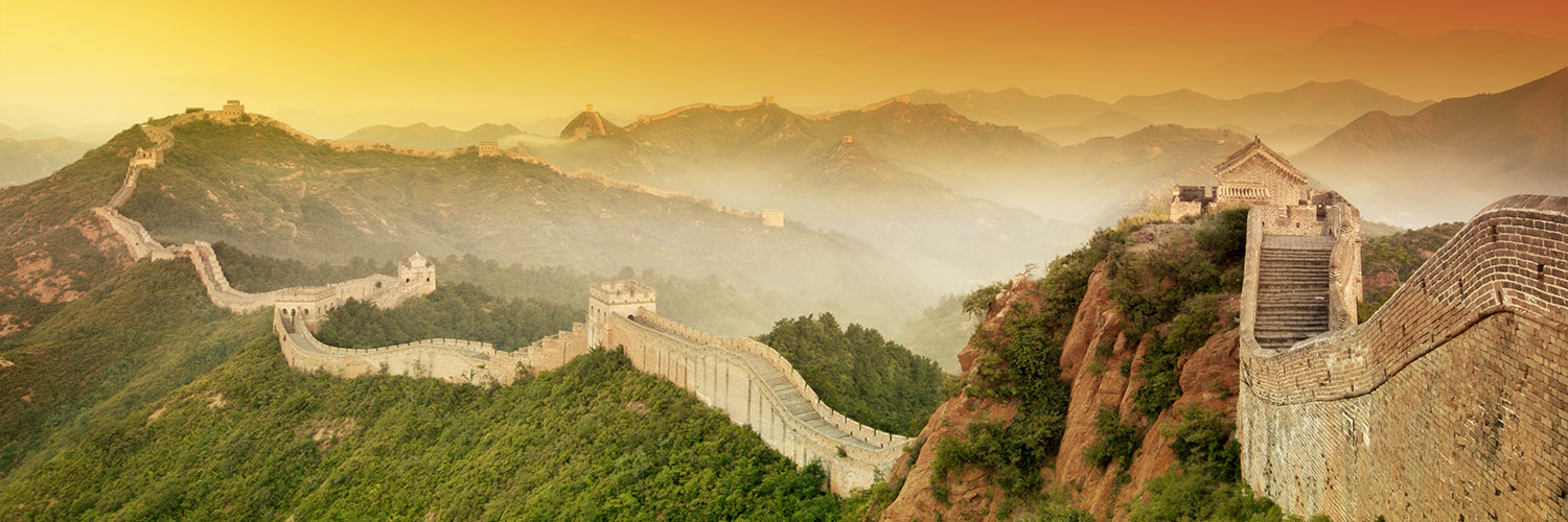 PHOTO: The Great Wall of China set against an orange hued sky.