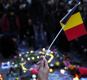 Photo Description: People gathered for a vigil in Brussels, Belgium.