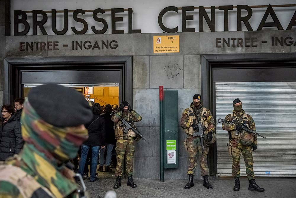 Photo Description: Belgian military units guarding the closed Centraal Train Station in Brussels.