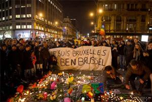 Photo Description: People gathered for a vigil in Brussels, Belgium, holding a sign that reads 'I am Brussels'.