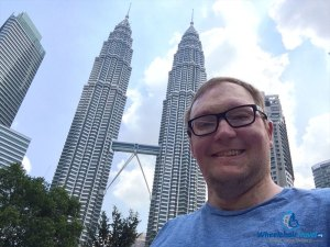 PHOTO DESCRIPTION: Selfie of John in front of the PETRONAS Twin Towers.