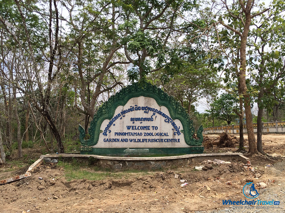 PHOTO DESCRIPTION: Sign at entrance to park that reads 'Phnom Tamao Zoological Garden and Wildlife Rescue Center'.