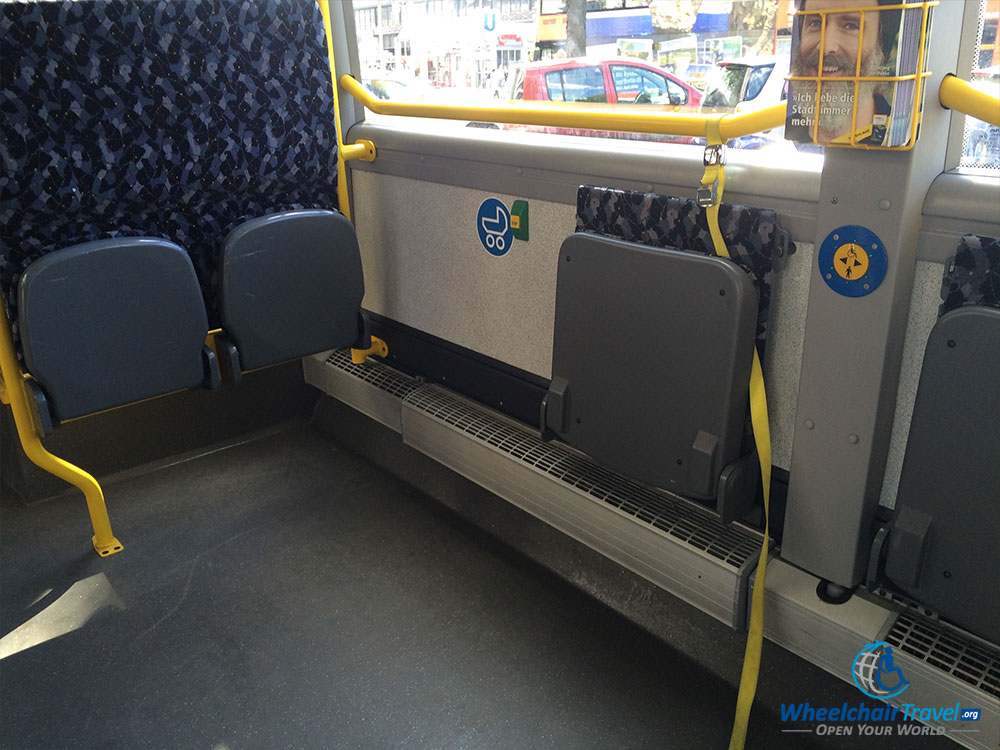 PHOTO DESCRIPTION: Reserved space for wheelchairs on a city bus in Berlin, Germany.