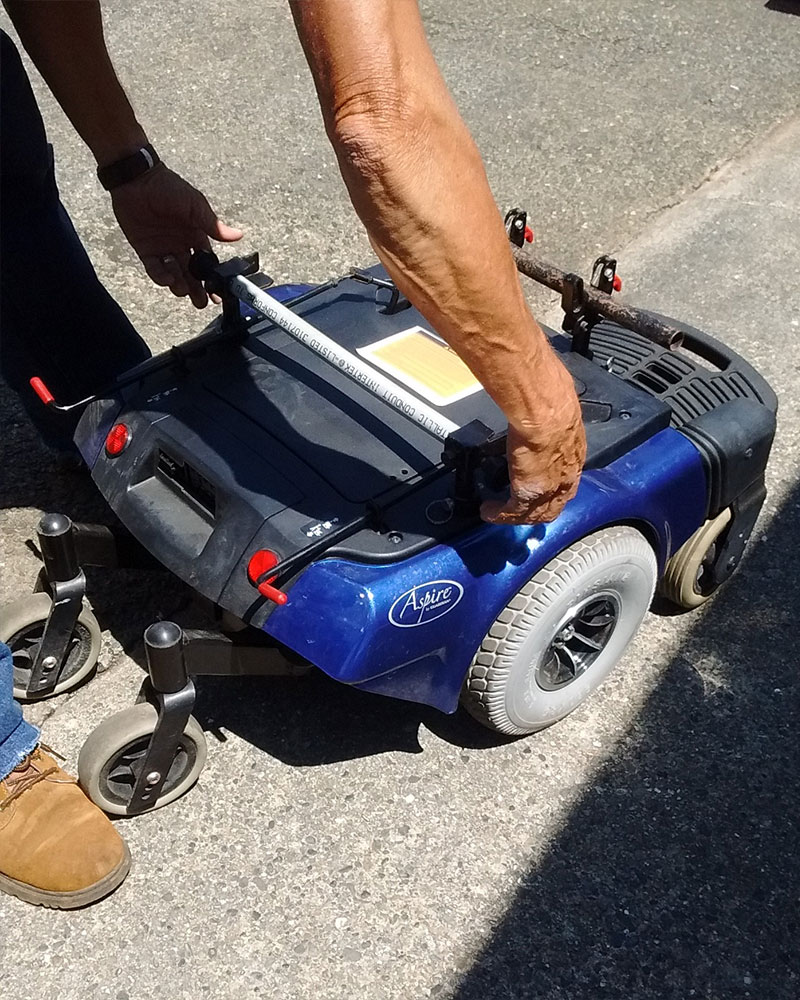 PHOTO DESCRIPTION: Disassembled power wheelchair base.