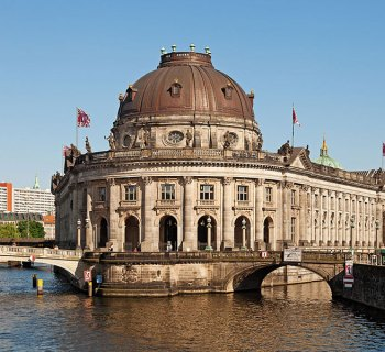 PHOTO DESCRIPTION: Spree River flowing around the Bose Museum and bordering Museum Island in Berlin, Germany.