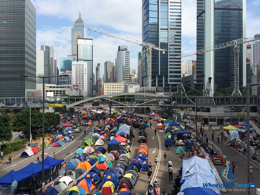 PHOTO DESCRIPTION: Umbrella Movement tent city set-up on a street in the Admiralty district of Hong Kong.