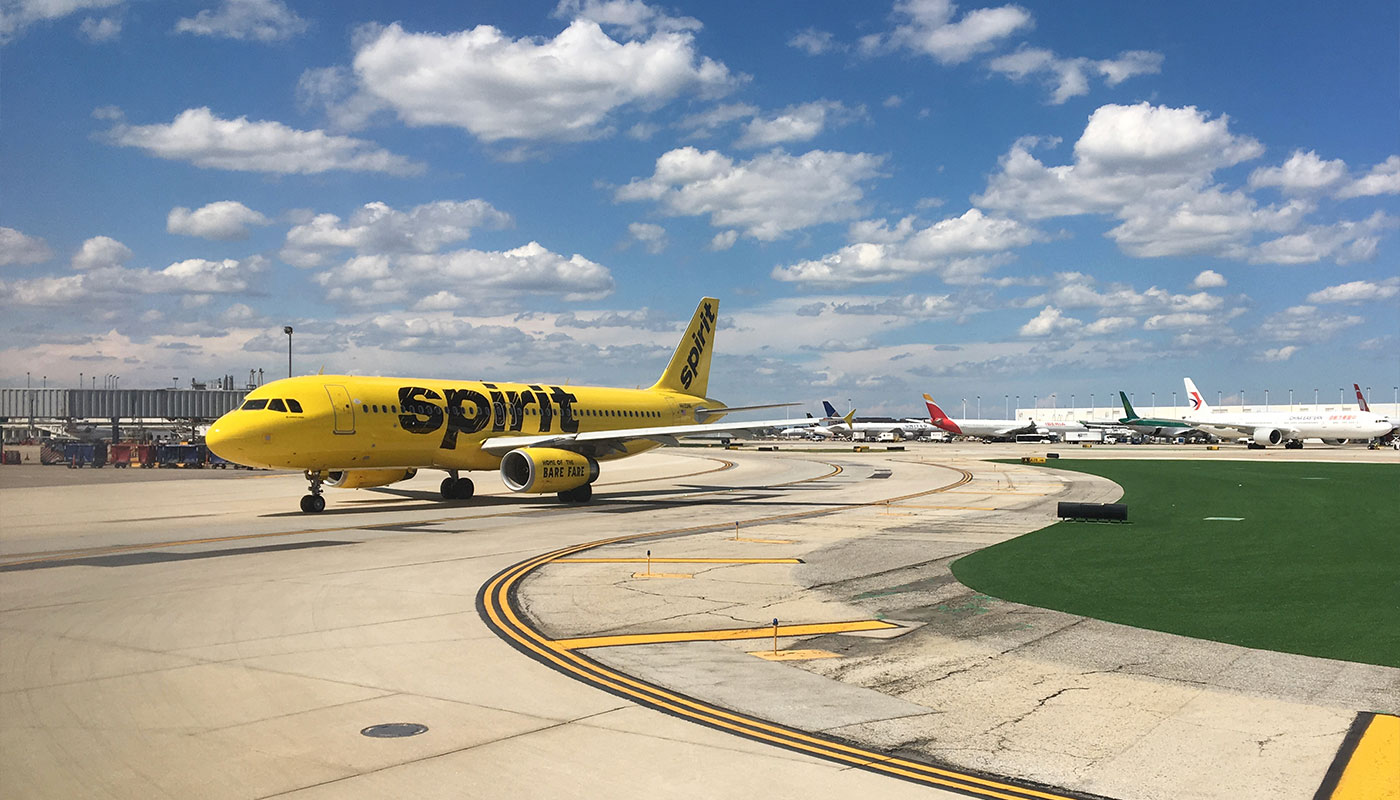 Spirit Airlines plane taxis on the runway.
