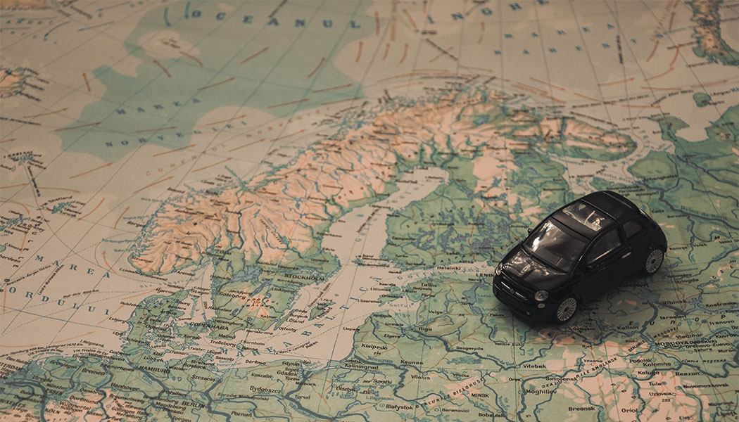 PHOTO: Toy car set atop a large world map.