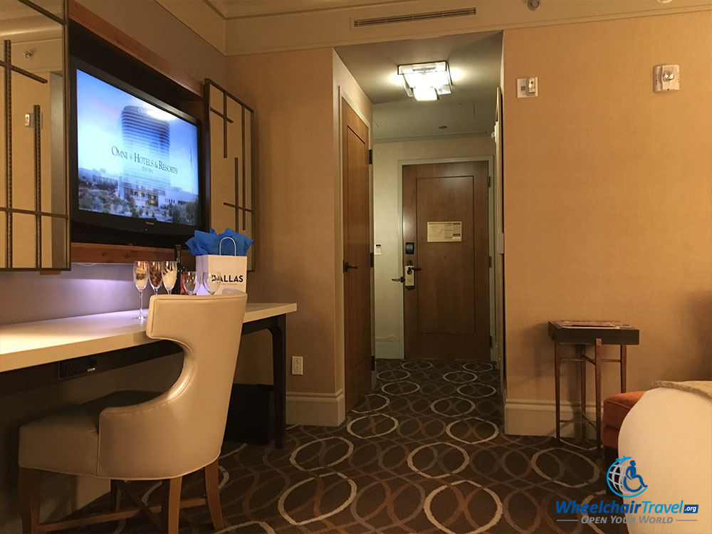 TV, desk, in-room hallway at Omni Dallas Hotel