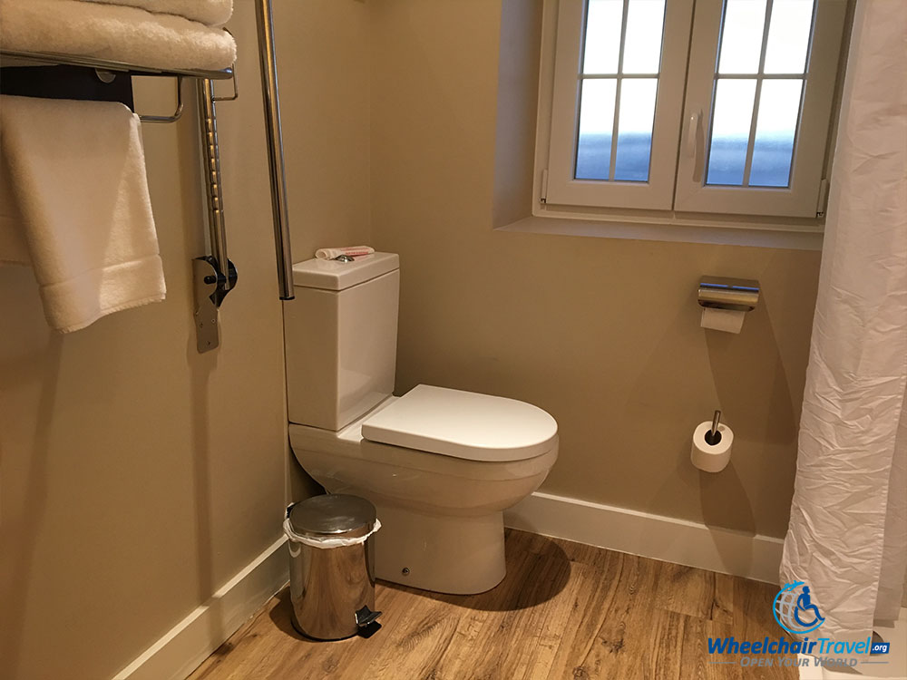 Bathroom toilet at the Rock Hotel with grab bar