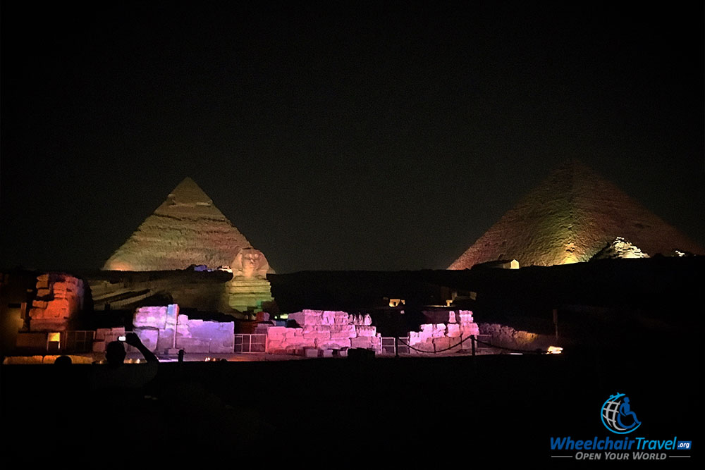 Khafre & Kufu Pyramids lit up at night, along with the Sphinx