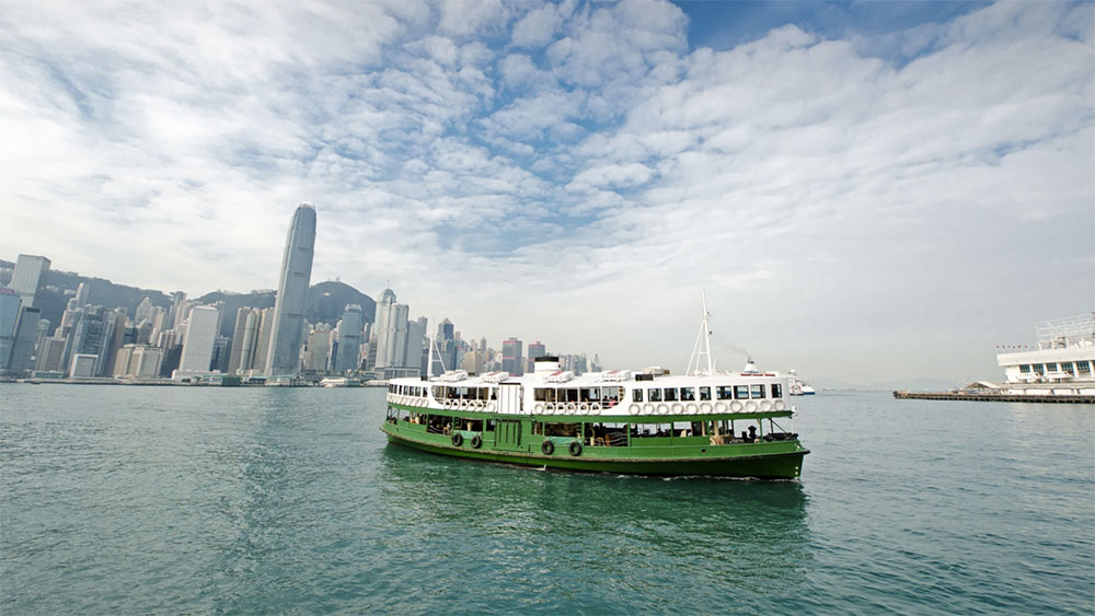Star Ferry crossing Victoria Harbour in Hong Kong, China.