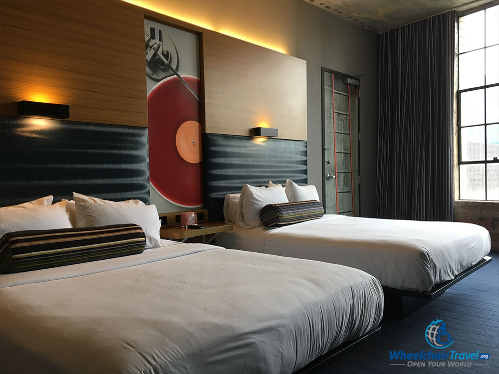Two queen size beds at Aloft Dallas Downtown hotel.