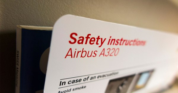 Airplane safety information card advises passengers how to evacuate, but travelers with disabilities are left out.