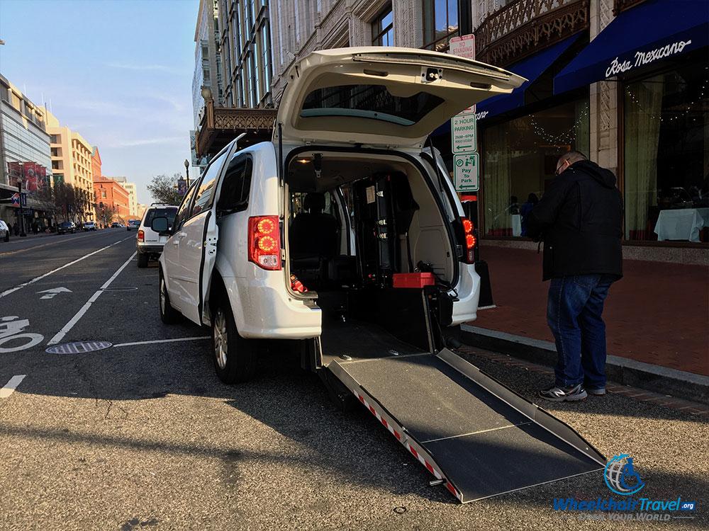 UberWAV Dodge Grand Caravan with rear-entry wheelchair ramp extended.