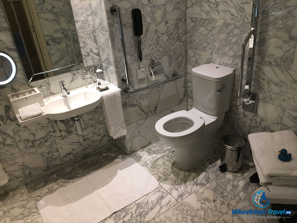 Accessible bathroom sink and toilet at St. Pancras Renaissance Hotel in London.