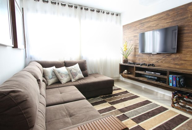 Living room set-up, with TV and sofa.