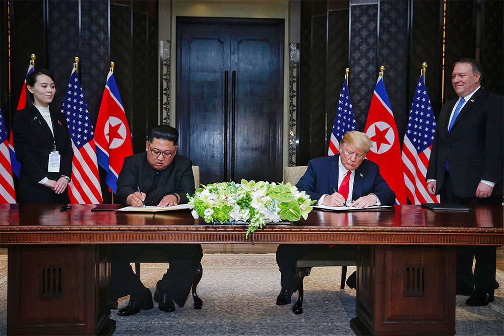 President Donald Trump and Chairman Kim Jong-un sign a bilateral agreement in Singapore.   Photo courtesy NBC News.
