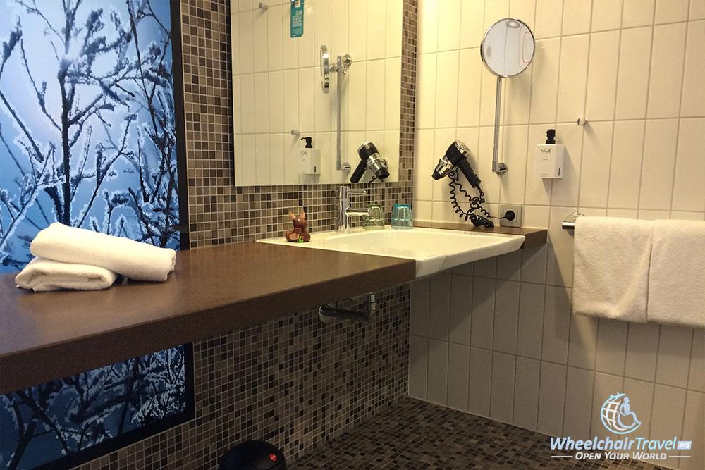 Wheelchair accessible bathroom sink at Scandic Berlin Potsdamer Platz hotel.