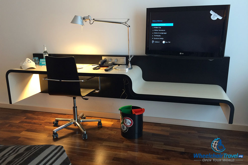 Wheelchair accessible work desk and media center.