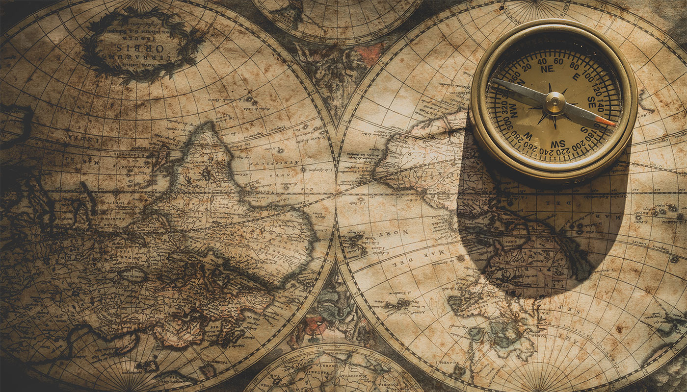 Historic world map with compass.