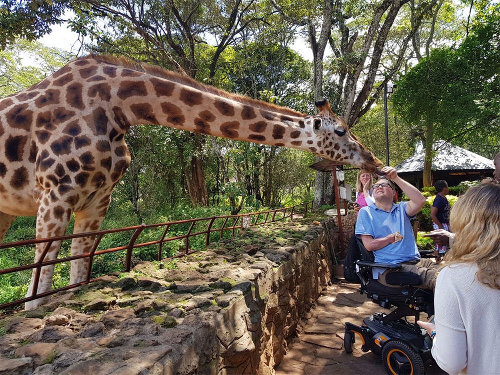 Feeding a giraffe at the Nairobi Giraffe Centre.