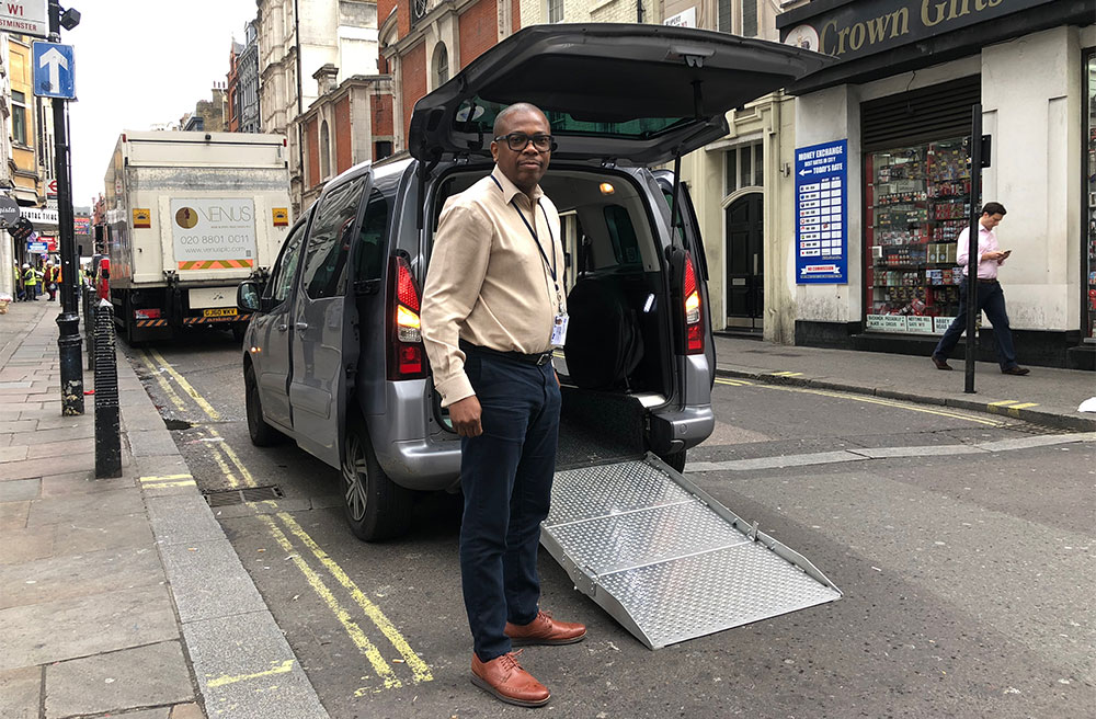 Wheelchair accessible Uber van with ramp in London, England.