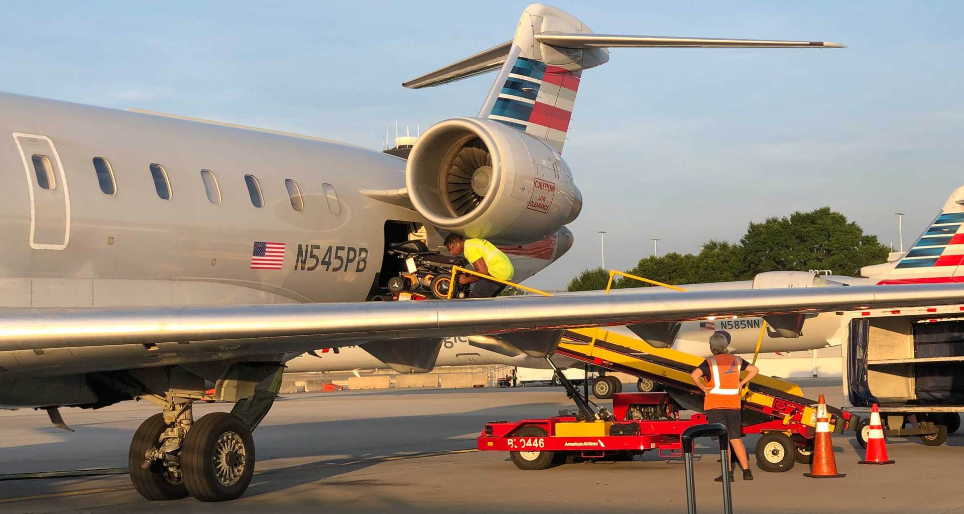 Power wheelchair loaded onto American Airlines CRJ-700 airplane.