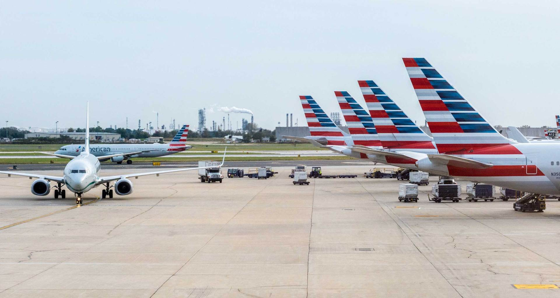American Airlines planes parked at airport terminal.