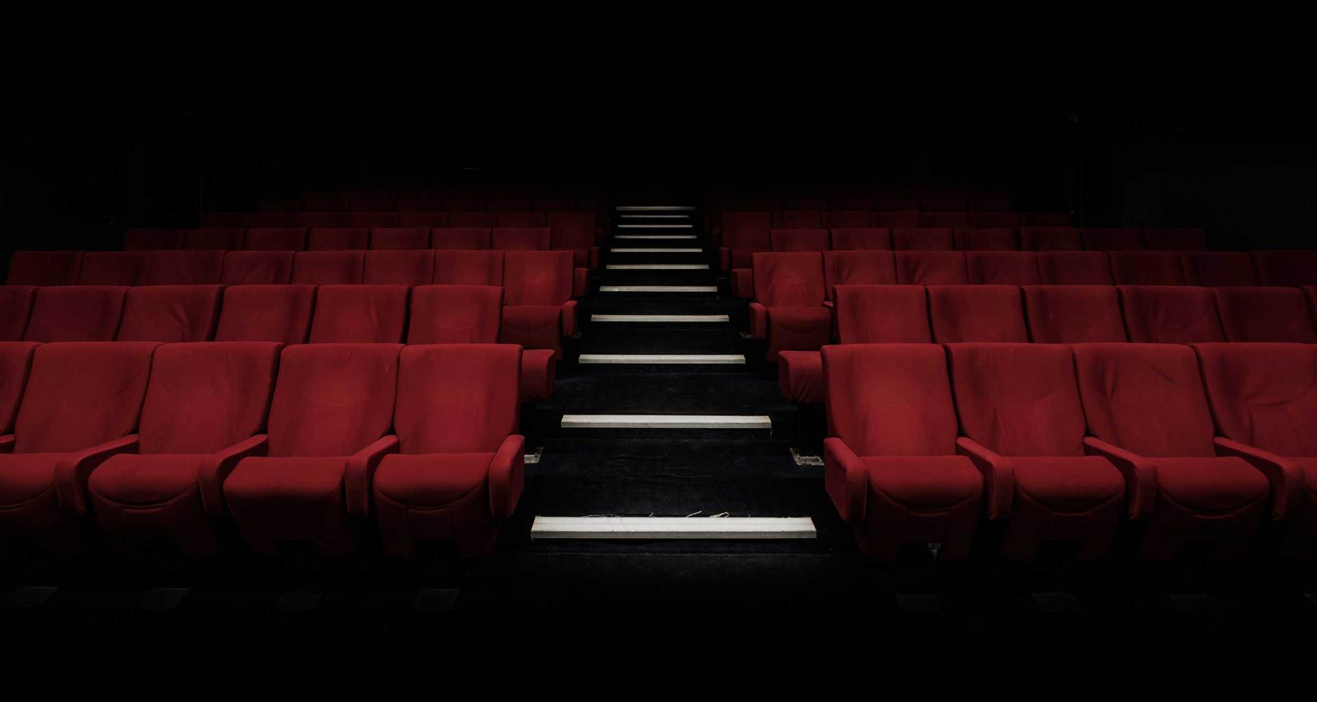 Seats in a darkened movie theater.