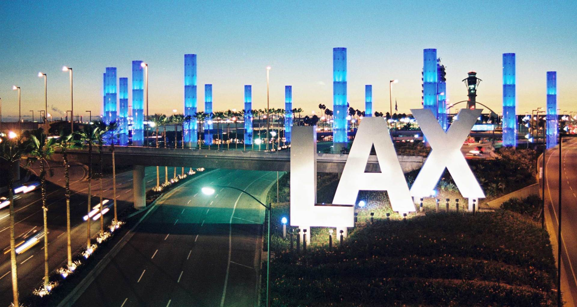 Large LAX sign outside the Los Angeles Airport.