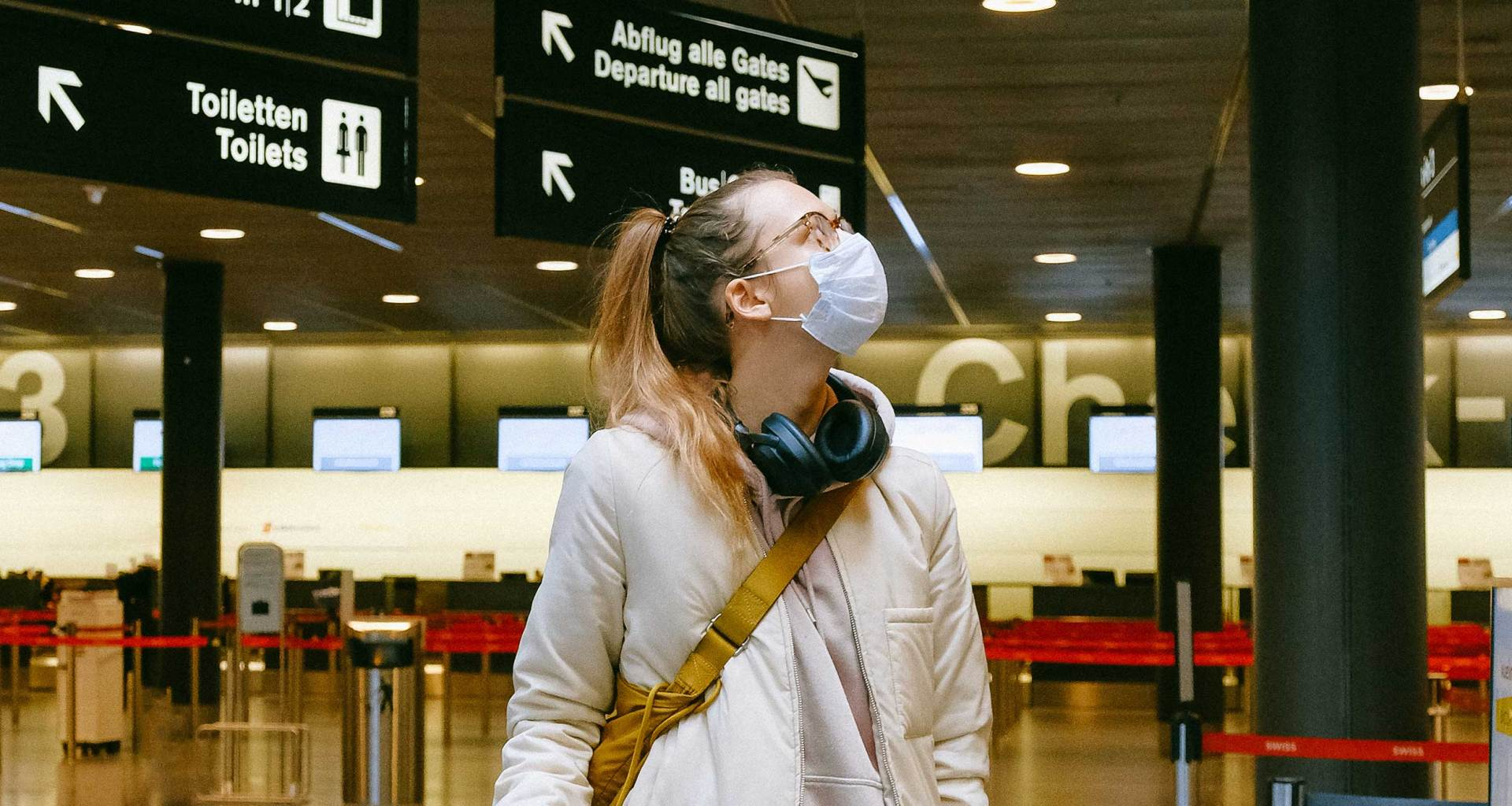 Woman wearing a mask in an airport.