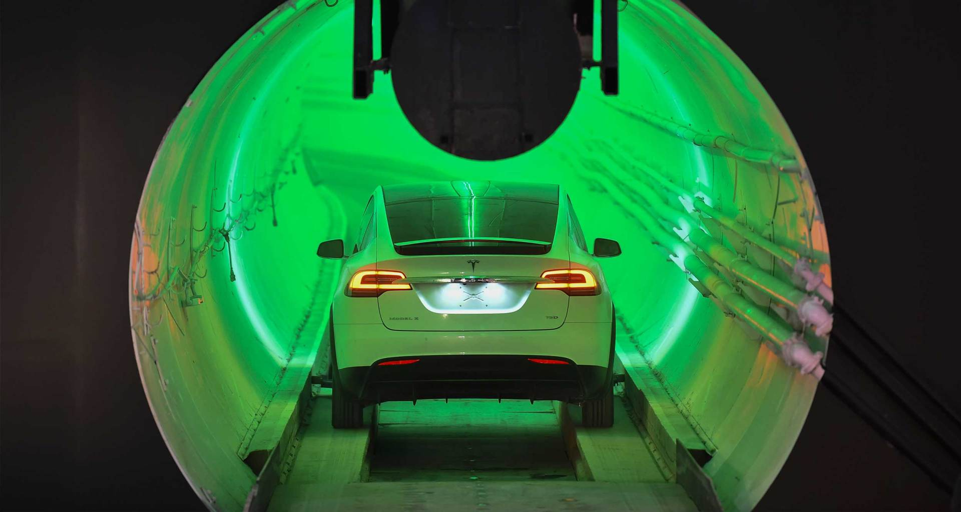 Tesla vehicle driving into an underground tunnel.
