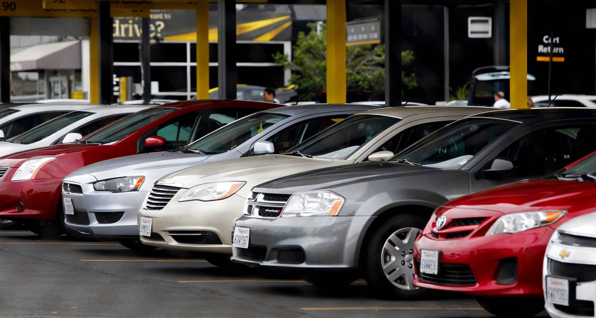Line of cars at a Hertz rental center.