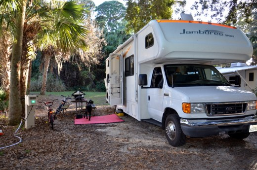 Our campsite here in the Cape Canaveral area backs up to a tiny creek that looks suspiciously like a drainage ditch but I won't look too closely. It's very tropical, though!