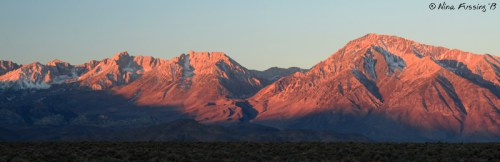 Sunrise paints the mountains red at our boondocking spot