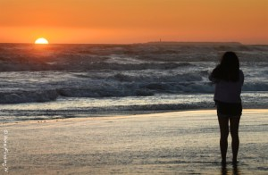 An aspiring photographer catches last rays at Kalaloch