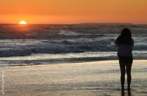 An aspiring photographer catches last rays at Kalaloch