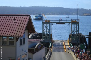 A line of walk-ons wait to board the Orcas Ferry