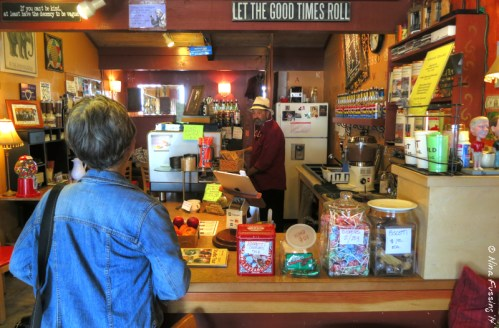 Laurel chats to the barista at Caffe La Boheme