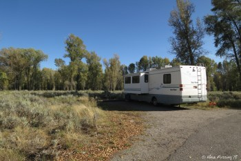 """Loop B -> View of one of the large, spacious river-facing sites. This is #106. The river-facing sites tend to be larger and you have no RV's obscuring your """"sitting area"""" view in the back."""