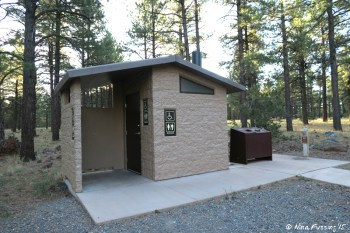 View of facilities (pit toilets). Multiple of these around each camping loop.